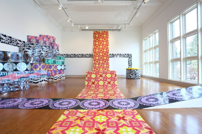 Untitled Installation, dimensions approximately 30′ x 20′ x 18′, mixed media: screenprints on linoleum, glitter, wood, paint, and faux leather vinyl, 2013. Urban Pop, Main Line Art Center, Haverford, PA. Curated by Amie Potsic.