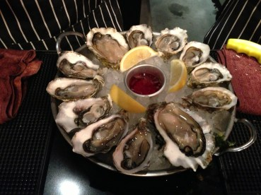 Well-presented platters of oysters with red wine vinegar and shallots