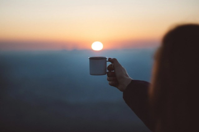 having early morning time to yourself by drinking a cup of coffee; self-care tips