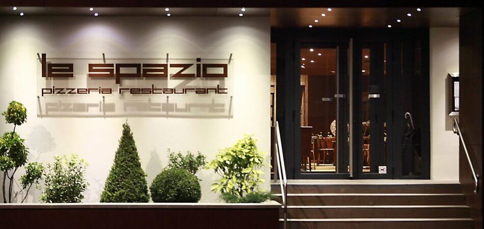 Entrée du Spazio avec parking privé et gratuit
