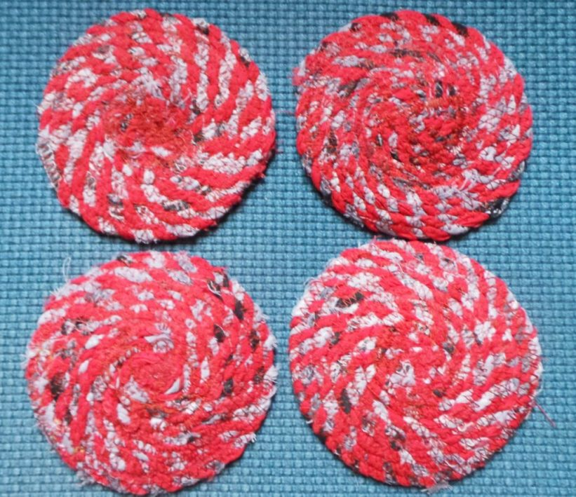 I added red fabric to make these coasters nicer