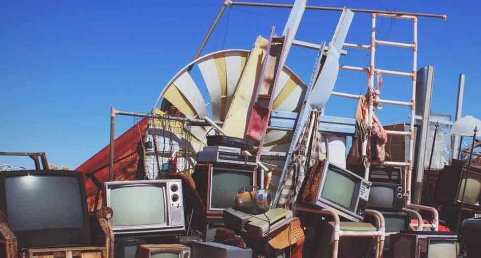 pile of broken tvs