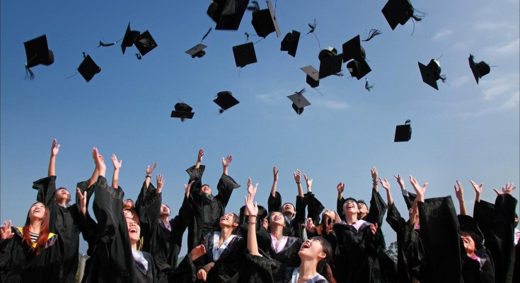 college students throwing graduation caps