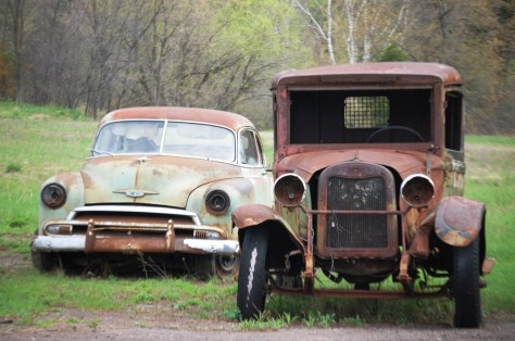 A couple of old cars near Hurley, WI as seen from Route 2