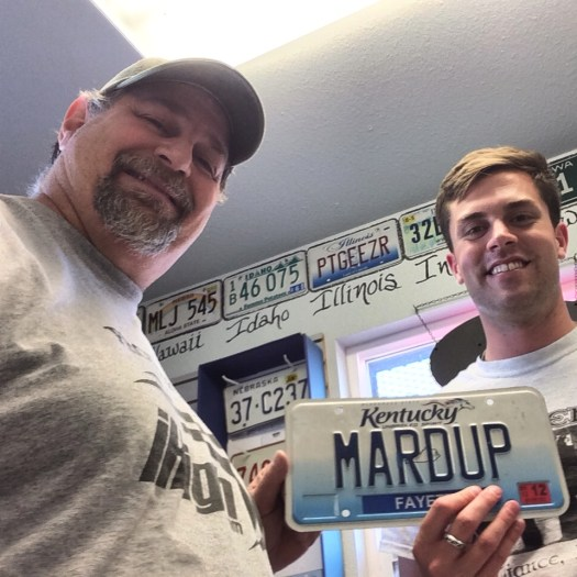"Donating ""MARDUP"" license plate at Carhenge"
