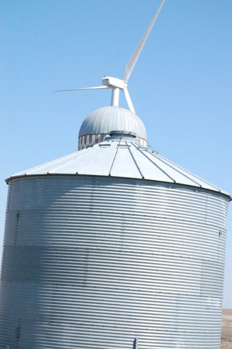 Three Structures: Metal silo, old silo, wind turbine