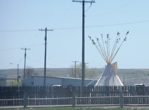 When I passed through Fort Belknap, there was a Pow Wow going on.  You can see the Tipi over the fence.