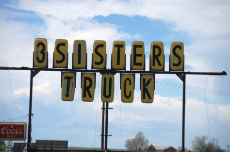 3 Sisters Truck Stop sign near Manville, WY