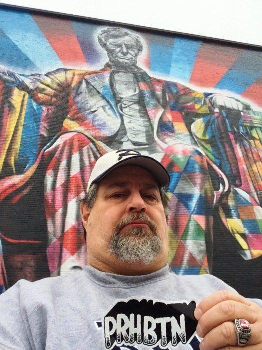 Sumoflam at Eduardo Kobra's Lincoln mural in downtown Lexington