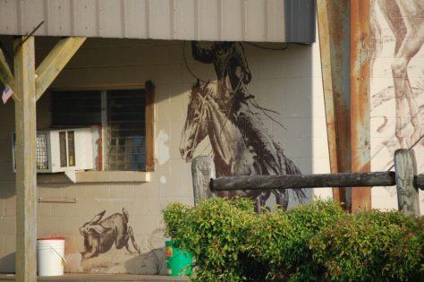 Front porch artwork at Cattlemen's Livestock Market in Glenwood, AR