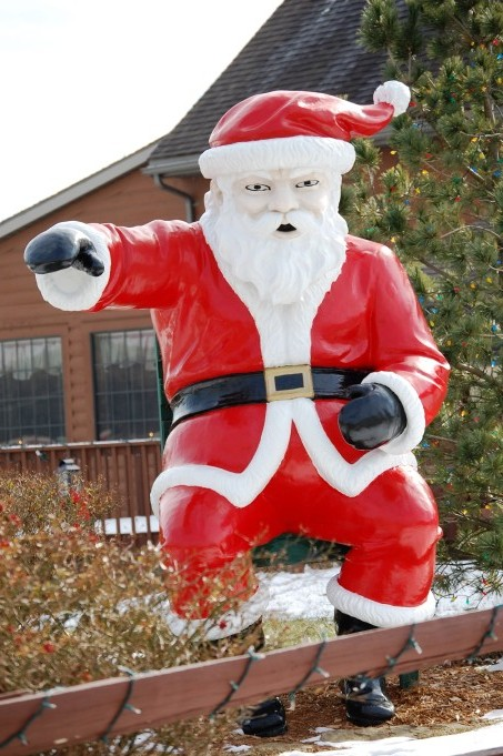 A Cranky Santa, stands about 9 feet tall