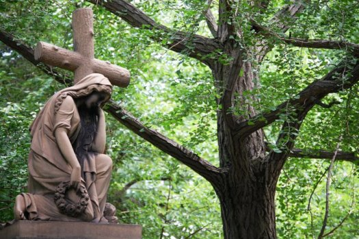 A solemn statue in Lake View Cemetery