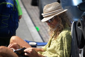 An artist relaxes by his booth along the waterfront in Seattle