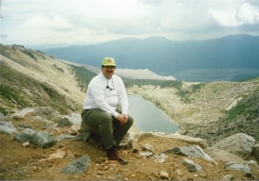 Sitting near the summit of Mt. Evans in Colorado overlooking Echo Lake in 1990. I love Colorado