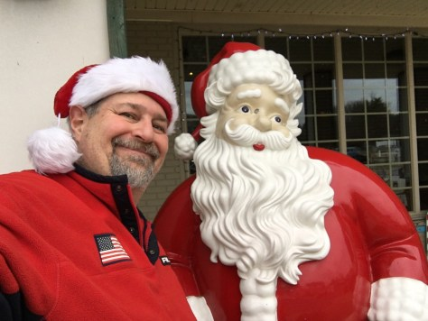 A Santa Selfie with the Santa in front of the Tourism Office