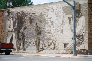 Harvey Jackson mural on a corner in Kemmerer, WY