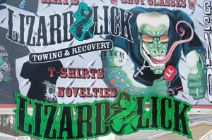 Lizard Lick Towing mural on sign outside of towing place