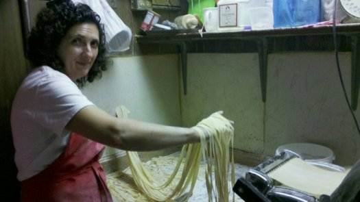 Mama Pina making her homemade pasta (courtesy of Mama Santa's Facebook)