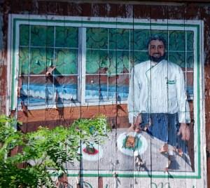 Mural in Damascus advertising the Old Mill Inn