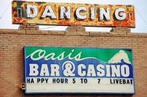 Oasis Bar - Shelby, Montana.  Love the old Dancing neon sign