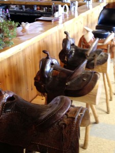 Bar Stools (or should I say saddles) at TJ's Cafe in Newell, SD