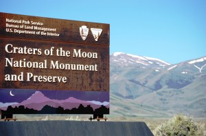 Craters of the Moon sign with mountains in background