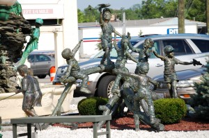 Bronze of children playing in front of Garden Palace Hotel in Williamsville, NY