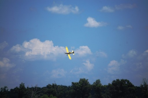 Aerial Spray plane rounding a turn near Dexter, Missouri