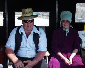 Mennonite father and daughter selling Maple Syrup