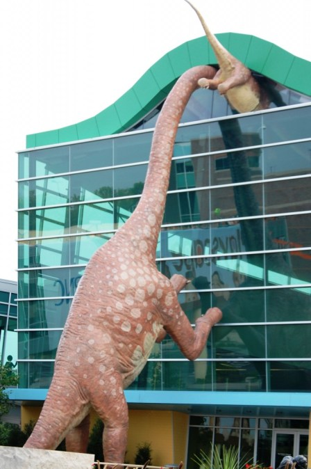 Dinosaurs peek into the Children's Museum