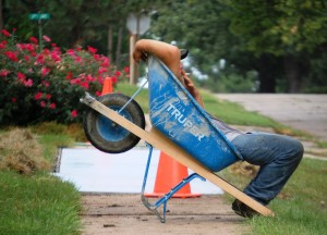 Man in Wheelbarrow