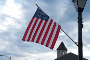 A Flag frames the top of the courthouse in Nebraska City