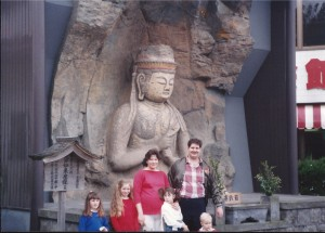 Family at Usuki Buddha statue in Usuki, Oita, Japan ca 1988