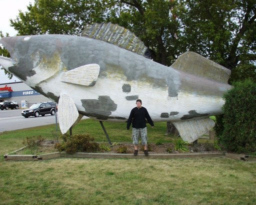 Solomon is dwarfed by the World's Largest Walleye in Baudette, MN Sept 2007