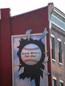 Giant Baseball breaking a Window in downtown Louisville