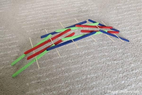 make a da vinci bridge with craft sticks and skewers