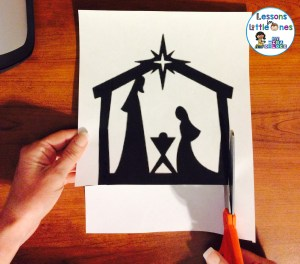 cutting out the Christmas silhouette