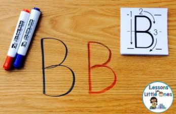 writing alphabet letters on desk
