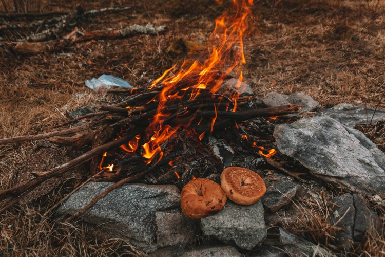 Bagels roasting on an open fire