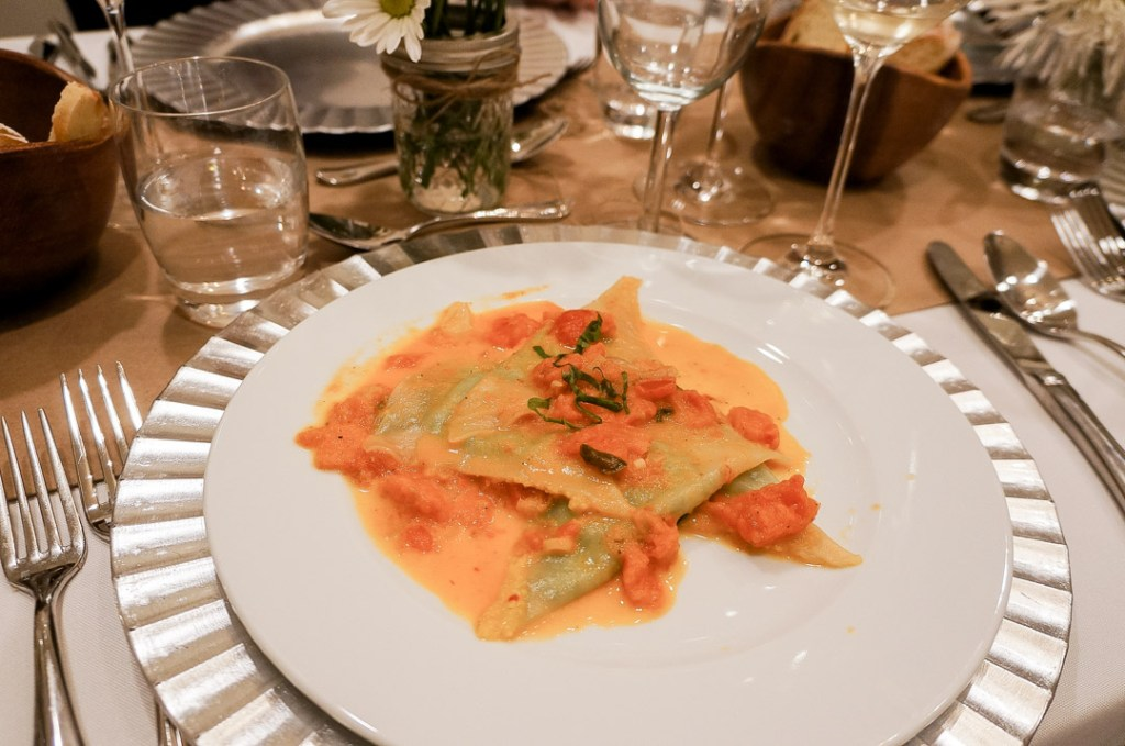 spinach ravioli with pink sauce