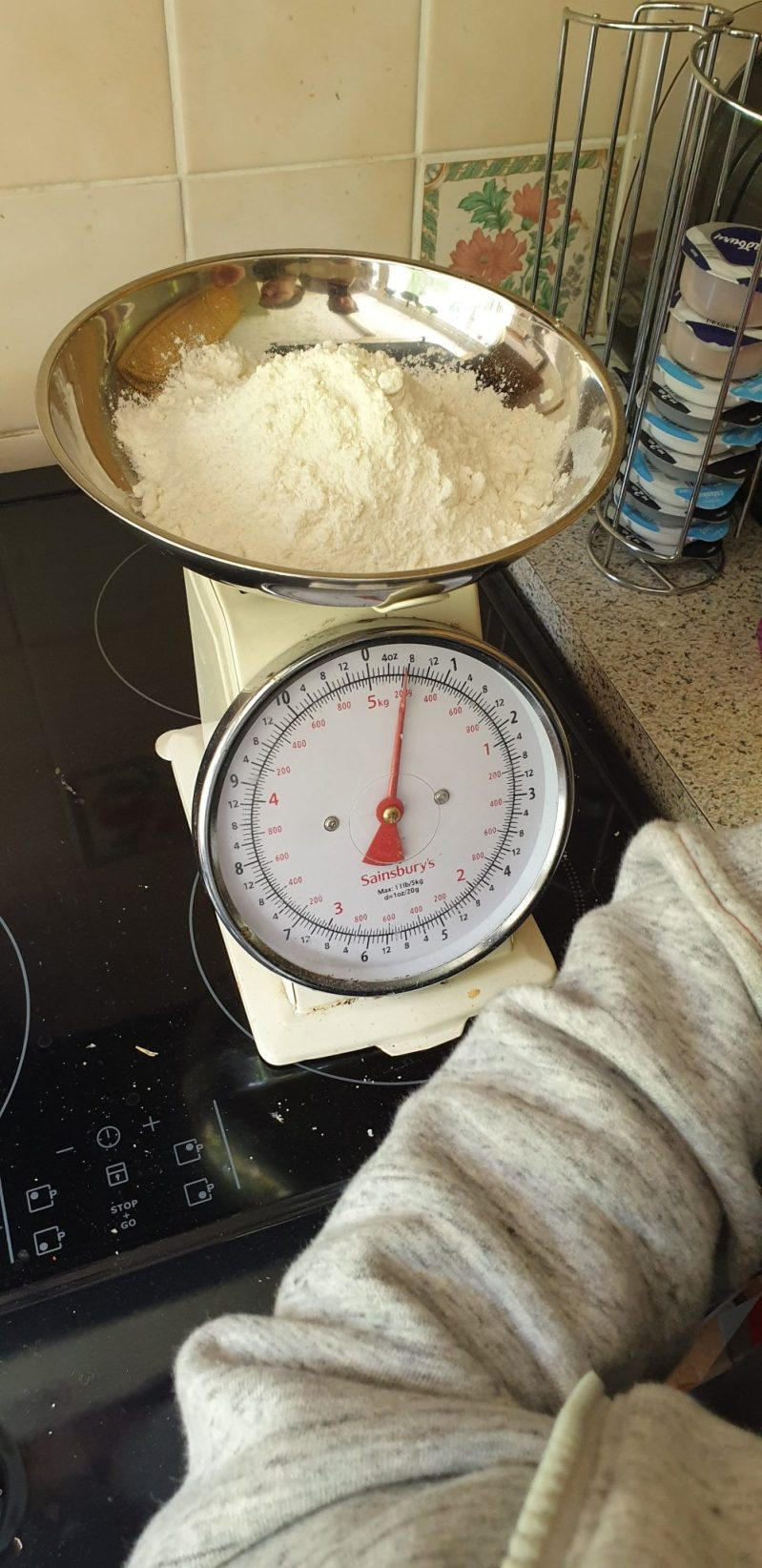 Measuring flour using a set of kitchen scales