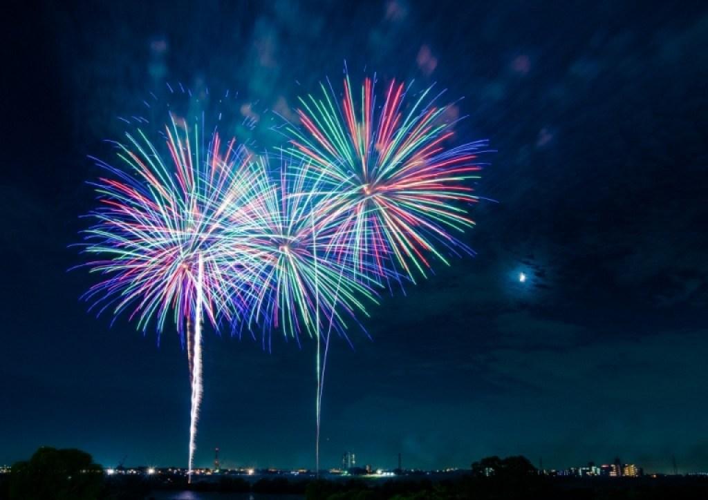 Fireworks on moonlit night