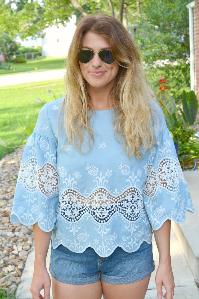 Ashley from LSR in a chambray and lace blouse and denim shorts