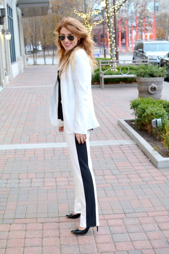 Ashley fro LSR in a white suit and and black pumps