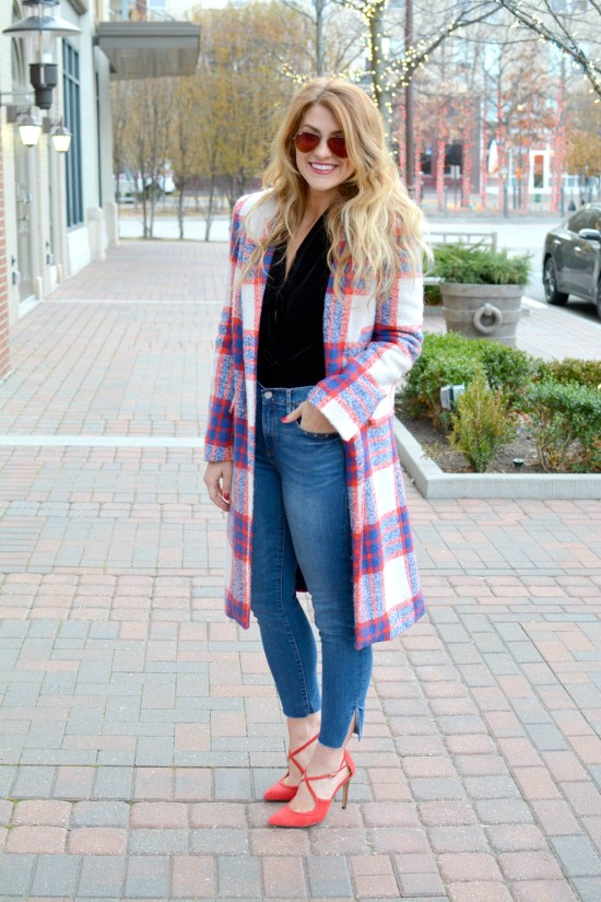 Ashley from LSR in a plaid statement coat, red pumps, and velvet bodysuit
