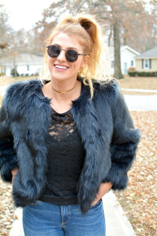 Ashley from LSR in a navy faux fur coat and black lace top