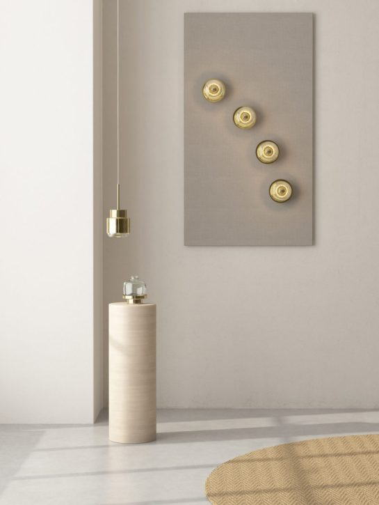 Perfect combination of the Cupallo pendant lamp, an arragement of Cupallo wall lamps and a Cupallo vase in brass