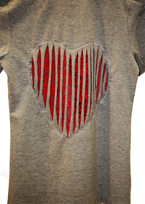 Refashion a T-Shirt with a Heart Cut Out for Valentine's Day - Refashion / upcycle those t-shirts with a a few snips and lace for the day of love. Step-by-step DIY sewing tutorial for upcycling clothes into some other type of clothing or accessory. Remake, redo, reuse, and recycle to help save money and save the planet. Explore the web site for more refashioning tutorials, dozens of cute refashionista and fashion ideas with good, clear photos and instructions. http://letgoofbeingperfect.com