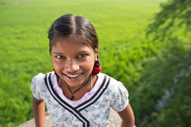 "Laxmi Pal, 12 years old, poses for a picture outside the Udaan Girls School in Hardoi, India. Laxmi, along with 24 of her classmates, were chosen to parcipitate in CARE's ""International Day of the Girl"" art exhibition in Atlanta, GA. In all, girls from 5 countries created works of art that were displayed in the exhibit. Photo by Josh Estey."