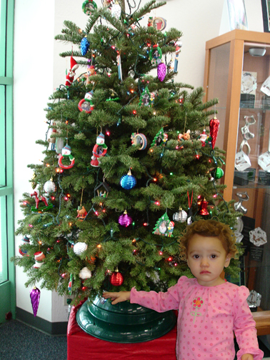 Lilah by the office Christmas tree